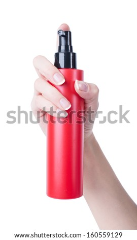 hair spray red bottle isolated on white background, pressing the hand of man - stock photo