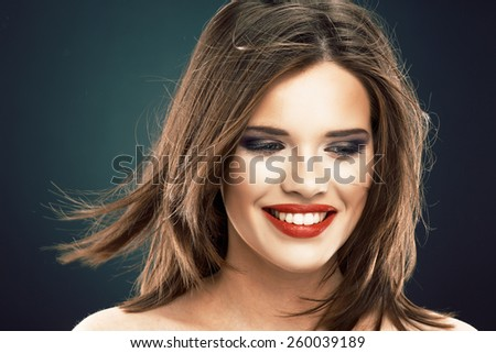 Hair style smiling woman portrait. Beautiful model  with long blowing hair.