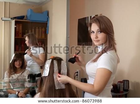 hair stylist coloring   long-haired girl hair - stock photo