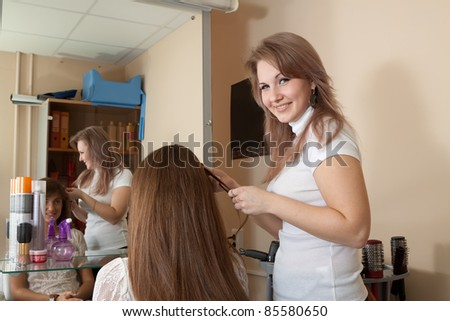 hair stylist work on woman hair in salon - stock photo