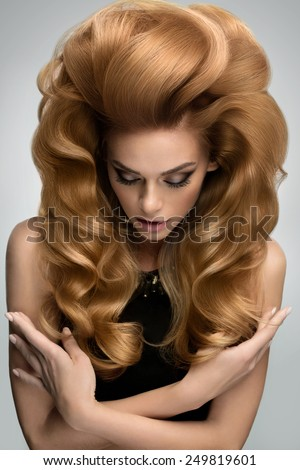 Hair volume.  Portrait of beautiful Blonde with Long Wavy Hair. High quality image. - stock photo