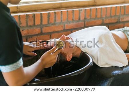 Hair washing at a beachfront hairdressing salon in Vietnam - stock photo
