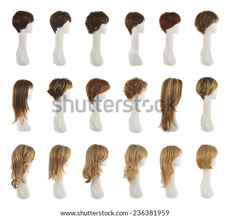 Hair wig over the white plastic mannequin head isolated over the white background, set of multiple different wigs in the side foreshortening - stock photo