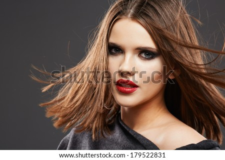 Hair. Woman Face Portrait. Red lips. Motion hair.