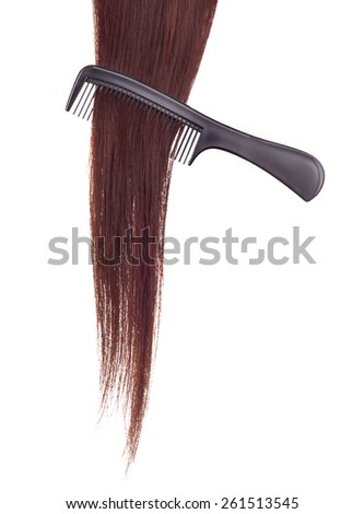 hairbrush and lock of hair on a white