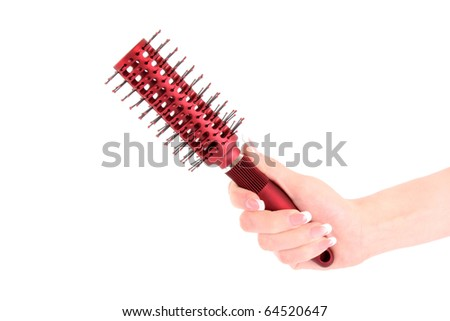 Hairbrush in hand isolated on white - stock photo