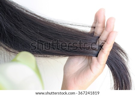 Haircare. Beautiful long haired woman blowing, drying hair, white background. - stock photo