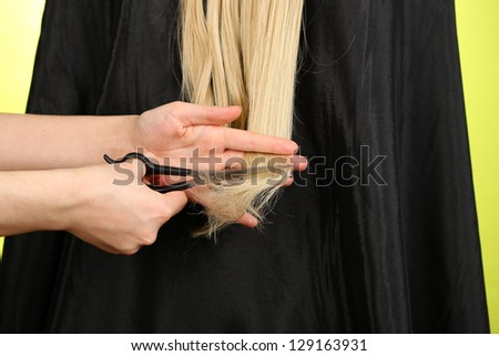 Haircut blond hair on green background