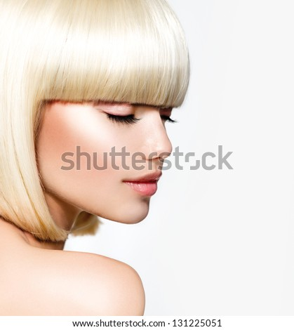 Haircut. Hairstyle. Hairdressing. Fringe. Beautiful Model with Short Blond hair. Bob. Fashion Blonde Girl - stock photo