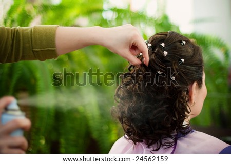 Hairdress modelling, the brunette, ringlets, hairpins, hairspray - stock photo