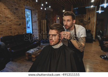 hairdresser adjusts hair of a customer