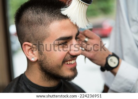 Hairdresser Cleaning Young Man After Haircut - Handsome Young Hairdresser Giving A New Haircut To Male Customer At Parlor