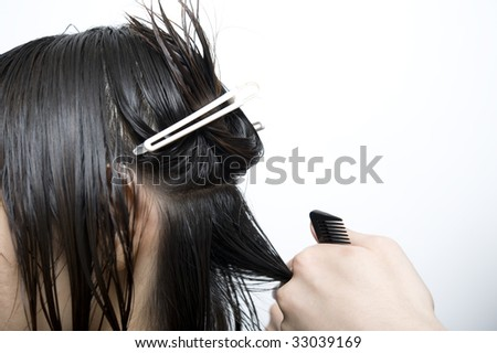 hairdresser cutting hair - stock photo