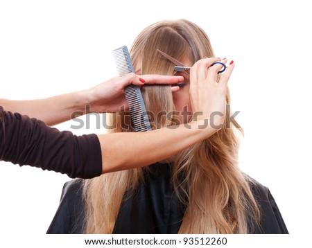 hairdresser cutting models fringe. isolated on white background - stock photo