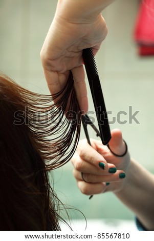 hairdresser cutting woman hair indoor - stock photo