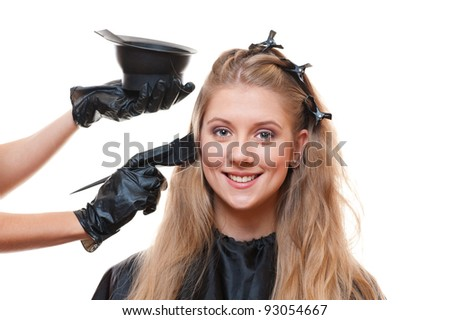 hairdresser doing hair dye. isolated on white background - stock photo
