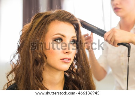 Hairdresser doing haircut for women in hairdressing salon. Concept of fashion and beauty. Positive emotion.
