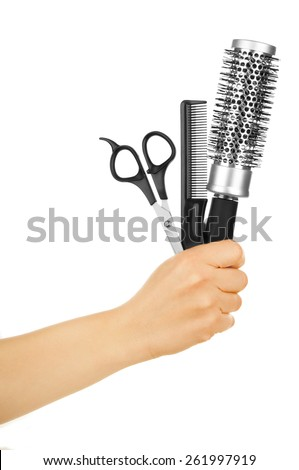 hairdresser holds scissors and hairbrush for haircut - stock photo