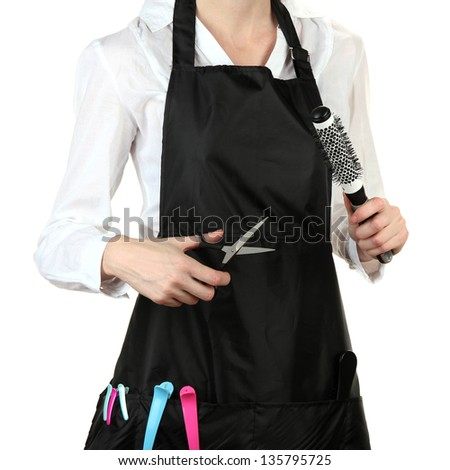Hairdresser in uniform with working tools, isolated on white - stock photo