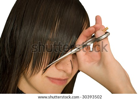 hairdresser is cutting young woman