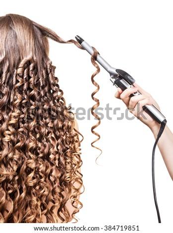 Hairdresser long curls girl groomed hair isolated on white background. - stock photo
