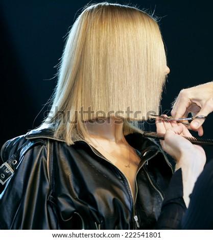 Hairdresser makes hair - stock photo