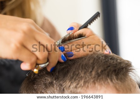 Hairdresser salon. Man during haircut - stock photo