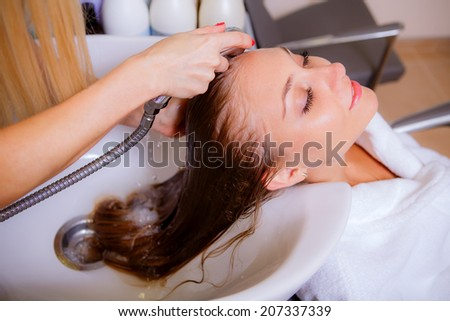 hairdresser washes head  girl, beauty, health,  close-up