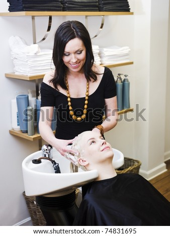 Hairdresser washing customers hair at a Beauty Spa