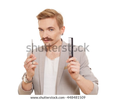 Hairdresser, wearing jacket, posing with scissors and comb. Stylish man studio portrait, isolated at white background. Barber with vintage facial hair style.