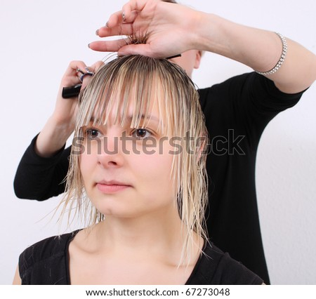 hairdressers mows blond woman - stock photo