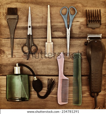 Hairdressing accessories. Retro concept. Scissors and combs on a wooden table. Toning - stock photo