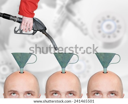 Hairless men's heads with funnels and fuel nozzle. Production line for education or brainwashing. - stock photo