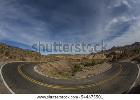 Hairpin turn along deserted highway