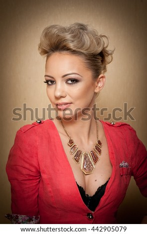 Hairstyle and Makeup, gorgeous female art portrait with beautiful eyes. Elegance. Genuine natural blonde with short hair in studio. Portrait of attractive woman with red blouse and glamorous necklace - stock photo
