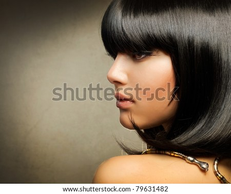 Hairstyle.Beautiful Brunette Girl.Healthy Hair - stock photo