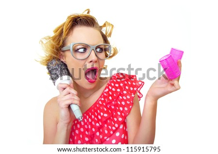 Hairstyle Pin-Up Girl holding curlers - stock photo