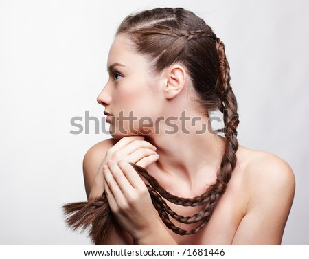 hairstyle portrait of beautiful brunette girl with creative braid hairdo