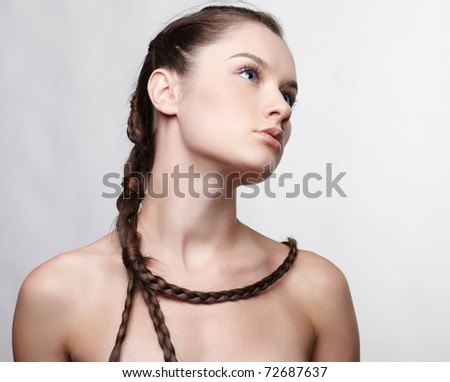 hairstyle portrait of beautiful brunette girl with creative braid hairdo - stock photo
