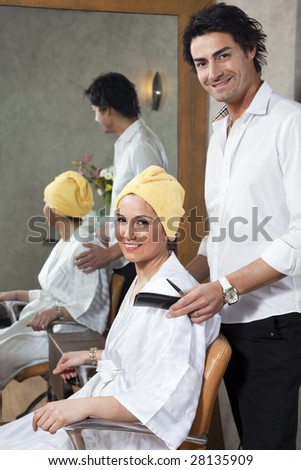 hairstylist and customer looking at camera and smiling - stock photo