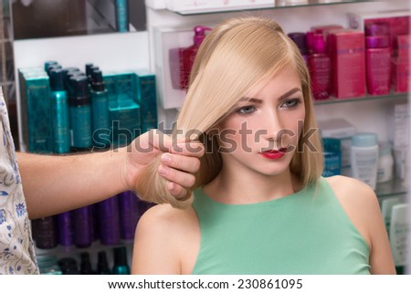 hairstylist makes hairstyle for beautiful girl - stock photo