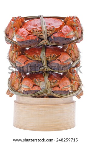 Hairy crabs on the Bamboo steamer Isolated in white background - stock photo