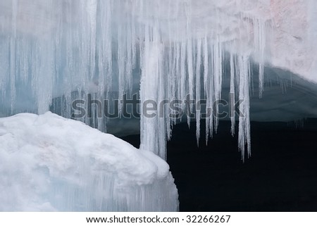 hairy icicles in front of cave - stock photo