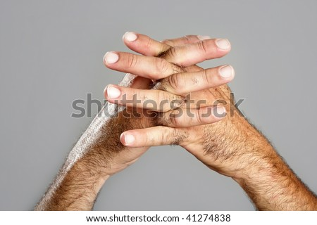 Hairy man hand closeup expression over gray background