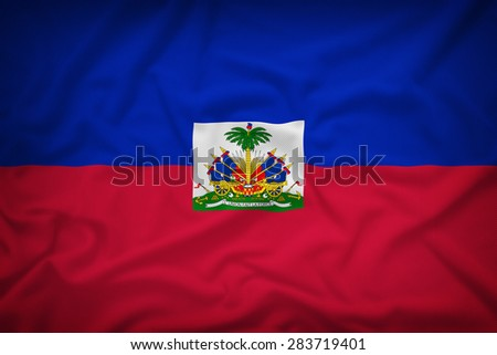 Haiti flag on the fabric texture background,Vintage style