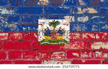 Haiti flag painted on old brick wall texture background - stock photo