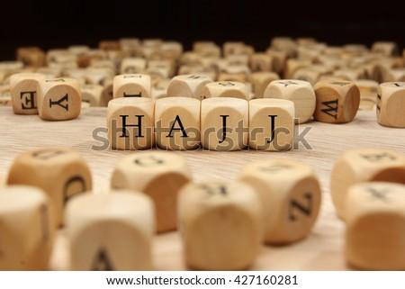 Hajj word written on wood block - stock photo