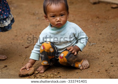 HAKHA, MYANMAR - JUNE 19 2015: Local boy in the Hakha region in Chin State, Myanmar. - stock photo