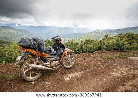 HAKHA, MYANMAR - JUNE 19 2015: Motorbike transportation in the Hakha region in Chin State, Myanmar. - stock photo