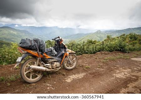 HAKHA, MYANMAR - JUNE 19 2015: Motorbike transportation in the Hakha region in Chin State, Myanmar. - stock photo